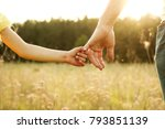 the parent holds the hand of a... | Shutterstock . vector #793851139