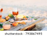 glass of rose wine on rustic...   Shutterstock . vector #793867495