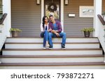 couple sitting on steps leading ... | Shutterstock . vector #793872271
