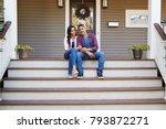 couple sitting on steps leading ...   Shutterstock . vector #793872271