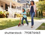 mother walks with son as he... | Shutterstock . vector #793876465