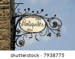 Sign with French text that means antique shop - stock photo