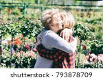 older lady hugging her... | Shutterstock . vector #793878709