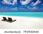 two empty sunbeds on a tropical ... | Shutterstock . vector #793930444
