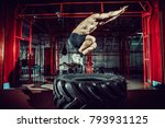 shirtless man jump in air over... | Shutterstock . vector #793931125