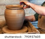Hands Of A Potter Making A...