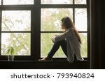 thoughtful girl sitting on sill ... | Shutterstock . vector #793940824