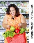 portrait of fat woman looks... | Shutterstock . vector #793963885