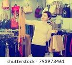 young female deciding on pretty ... | Shutterstock . vector #793973461