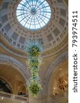 Small photo of LONDON, UK - CIRCA JANUARY, 2018: Victoria and Albert Museum hall. V&A Museum is the world's largest museum of decorative arts. In 2000, an 11-metre high, blown glass chandelier by Dale Chihuly.