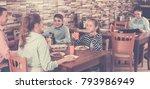 smiling family having lunch in... | Shutterstock . vector #793986949