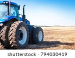 Blue Tractor On The Background...