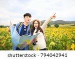 happy asian couple tourist... | Shutterstock . vector #794042941