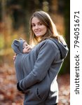 mother  carrying her baby boy... | Shutterstock . vector #794051671