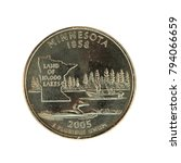 Small photo of A 2005 Minnesota quarter showing the state nickname and fishing scene isolated on a white background.