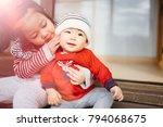 little sister hugging her baby... | Shutterstock . vector #794068675