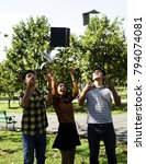 Small photo of The young student throw books on the air with friend in the park. Group of teenage students throw book on air celebrating complete academic year. girl joyfully threw books on a sunny day : Education