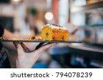waiter at restaurant carries... | Shutterstock . vector #794078239