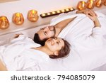 man and woman lying down on... | Shutterstock . vector #794085079