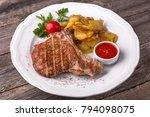 pork steak on the bone cooked... | Shutterstock . vector #794098075