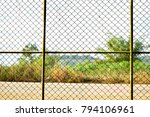 Small photo of the door or wall made by metal net entrance to out side free world, abstract concept.