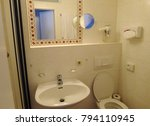 a bathroom in a white tile   Shutterstock . vector #794110945
