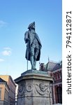 Small photo of Bergen, Norway - 08/24/2013: Statue of baron Ludvig Holberg in centre of the city, sunny day