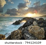 wave splashing on the sea rocks ... | Shutterstock . vector #794124109