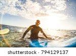 guy surfer relaxing on...   Shutterstock . vector #794129137