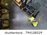warehouse workers after an... | Shutterstock . vector #794138329