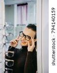 beautiful young woman choosing... | Shutterstock . vector #794140159