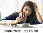 stressed young asian woman... | Shutterstock . vector #794140585