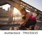 woman tying running shoes laces ... | Shutterstock . vector #794153215