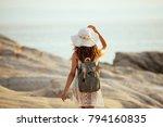 rear view of a woman walking on ... | Shutterstock . vector #794160835