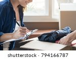 happy woman checking stuff in... | Shutterstock . vector #794166787