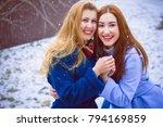 two cheerful girls best friends ... | Shutterstock . vector #794169859