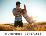 father spinning his daughter in ... | Shutterstock . vector #794171665