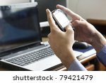 man sending or reading sms on... | Shutterstock . vector #79421479