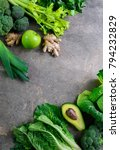 Small photo of Green fruits and vegetables arrangement simbolising vegetarian or healthy alimentary products for keeping detoxifying or getting skinny diet, flat lay template with blank space for a text, view from