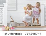 two little girls play in the... | Shutterstock . vector #794245744