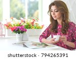 young woman reading magazine | Shutterstock . vector #794265391