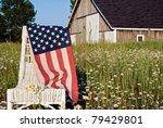 American Flag Draped Over...