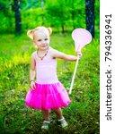 happy little girl wearing a... | Shutterstock . vector #794336941