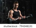 brutal strong athletic men... | Shutterstock . vector #794348131
