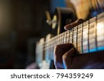 guy is playin electric guitar | Shutterstock . vector #794359249