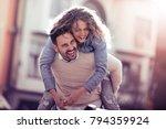 happy young couple having fun... | Shutterstock . vector #794359924