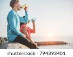 fitness young couple drinking... | Shutterstock . vector #794393401