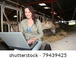 Veterinarian In Barn With...
