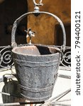 a water well with an old bucket ... | Shutterstock . vector #794400121
