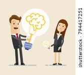 businessman hold a big light...   Shutterstock .eps vector #794417251